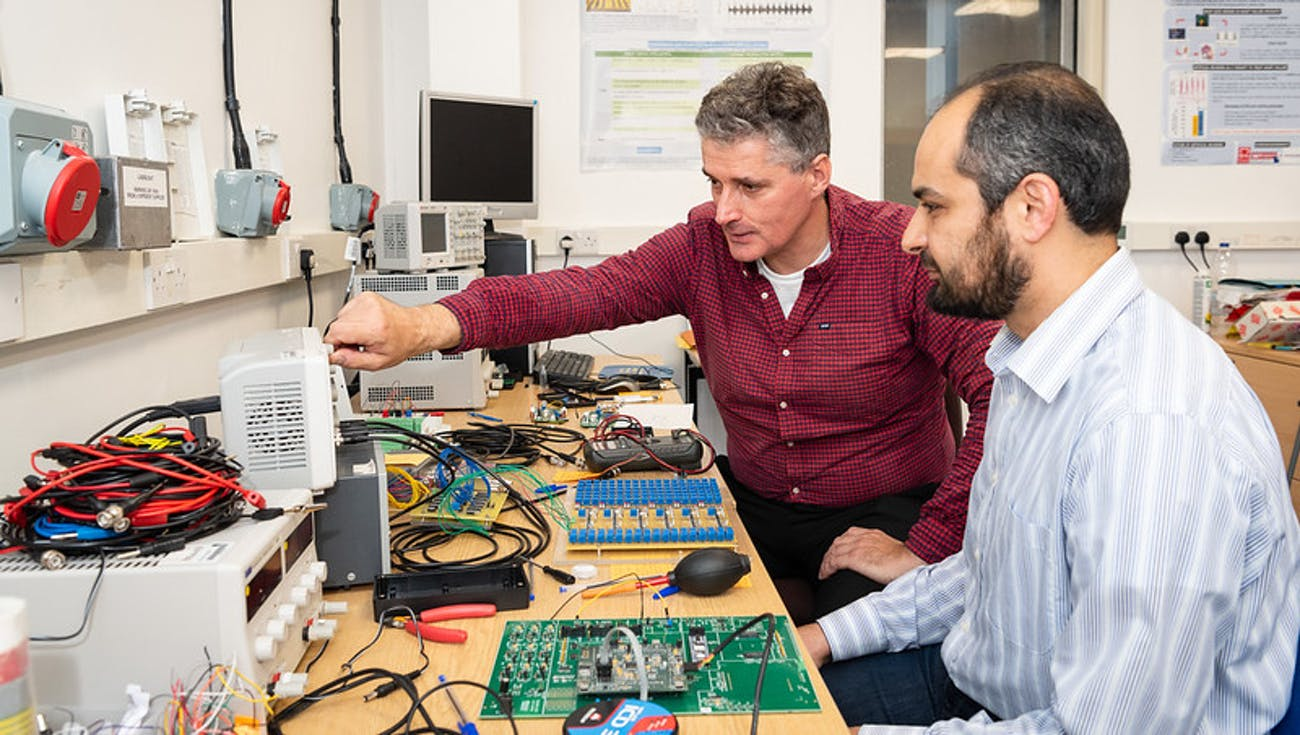 Prof Alain Nogaret and Dr Kamal Abu-Hassan in their lab.