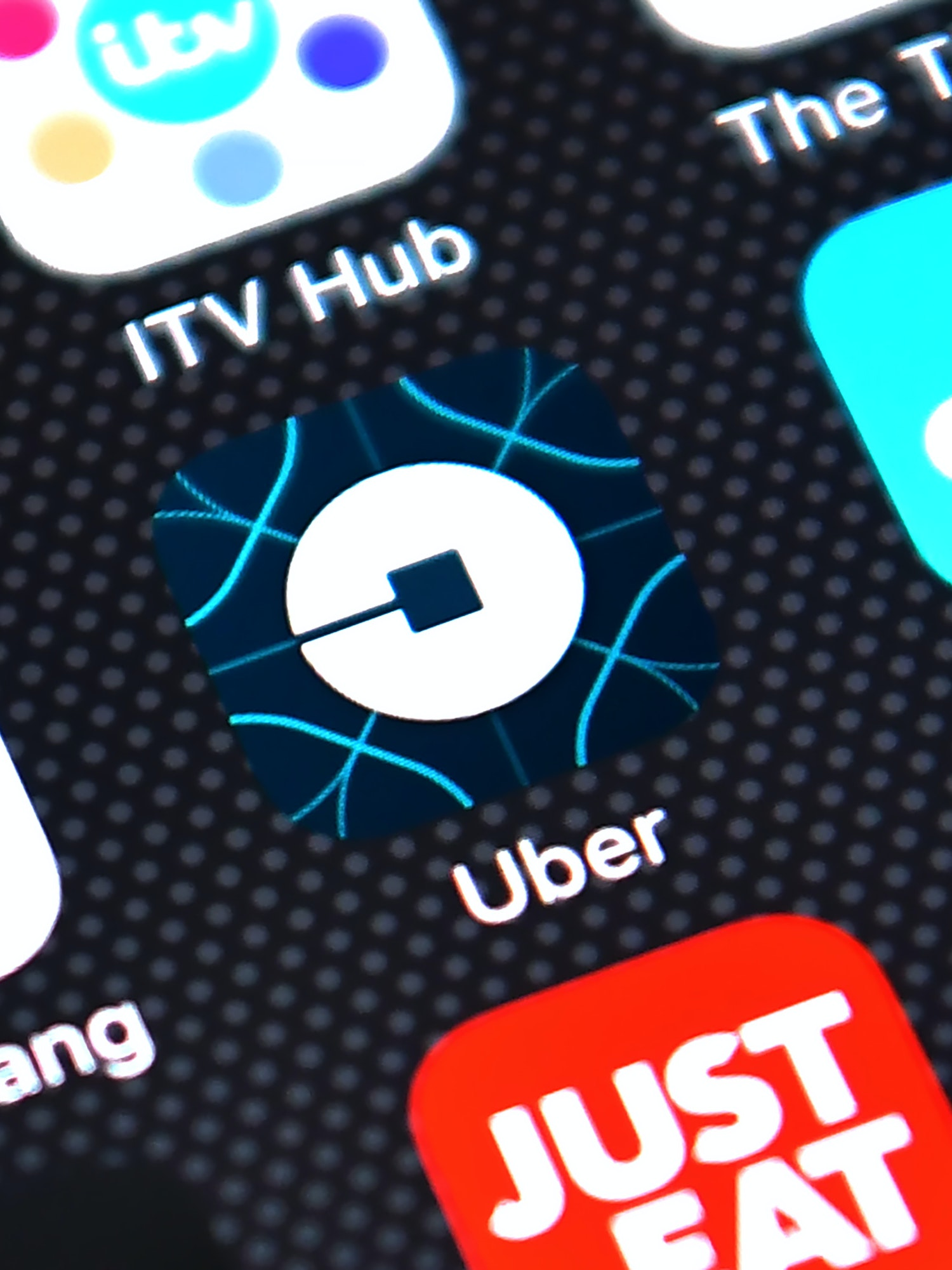 The Uber app logo is displayed on an iPhone on August 3, 2016 in London, England.