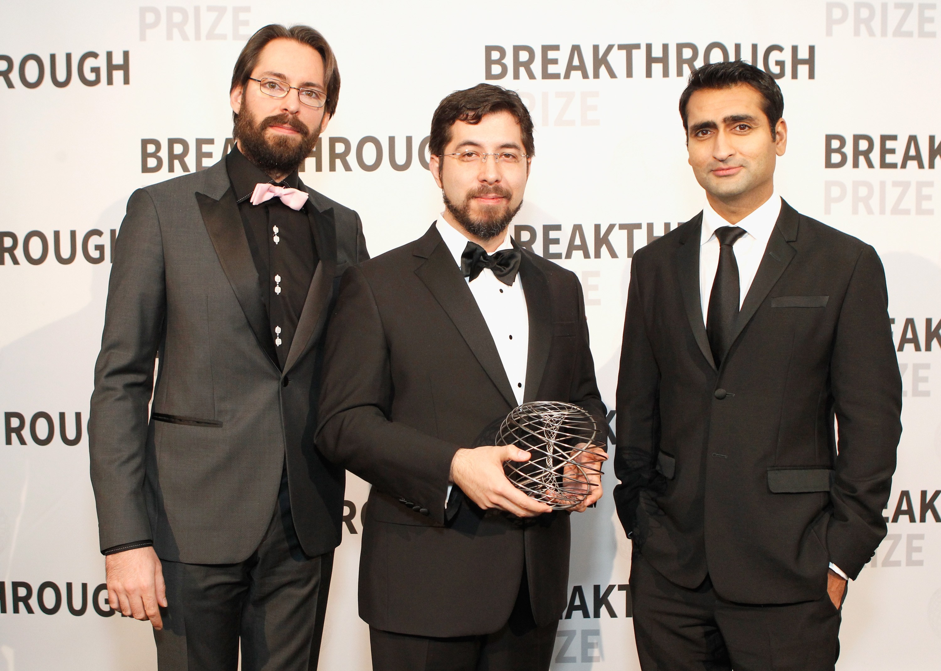 Actor Martin Starr, Associate Professor, Edward S. Boyden, PhD, posing with the 2016 Breakthrough Prize in Life Sciences, and actor Kumail Nanjiani attend the 2016 Breakthrough Prize Ceremony on Sunday.