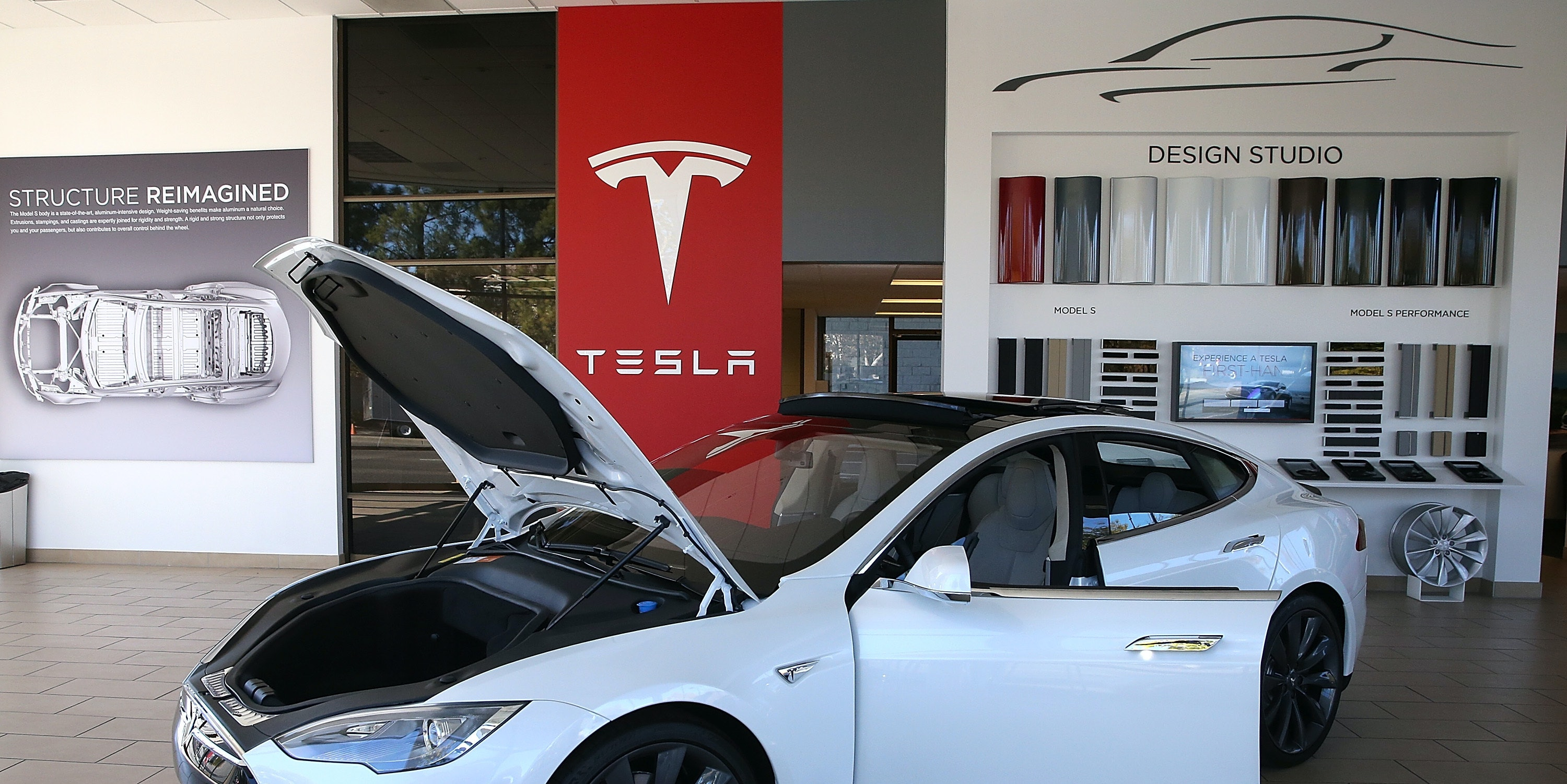 PALO ALTO, CA - NOVEMBER 05:  A Tesla Model S car is displayed at a Tesla showroom on November 5, 2013 in Palo Alto, California. Tesla will report third quarter earnings today after the closing bell.  (Photo by Justin Sullivan/Getty Images)