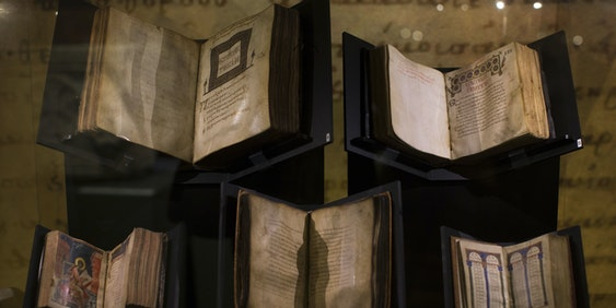 JERUSALEM, ISRAEL - OCTOBER 23:  (ISRAEL-OUT) Ancient biblical manuscripts are displayed at the 'Book of Books' exhibition in the Bible Lands Museum on October 23, 2013 in Jerusalem, Israel. The exhibition contains more than 200 of the rarest biblical manuscripts, including original fragments from the Septuagint and the earliest New Testament Scriptures. This exhibition opened in Israel before heading to the Vatican and ends in Washington D.C, where it will be permanently displayed.  (Photo by Uriel Sinai/Getty Images)