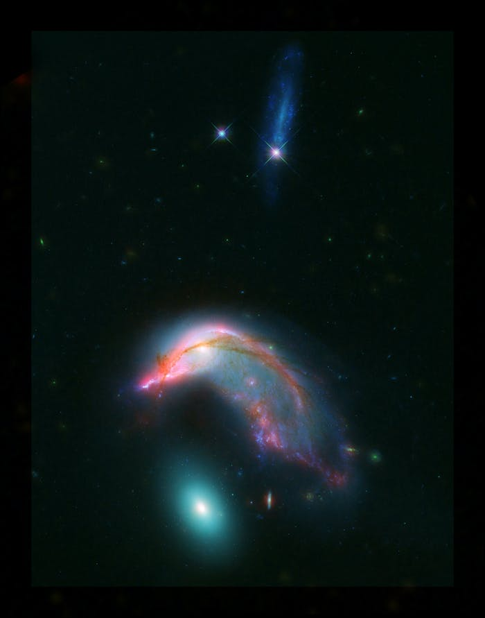 Distant interacting galaxies, known collectively as Arp 142, bears an uncanny resemblance to a penguin guarding an egg. Published by NASA on February 1.