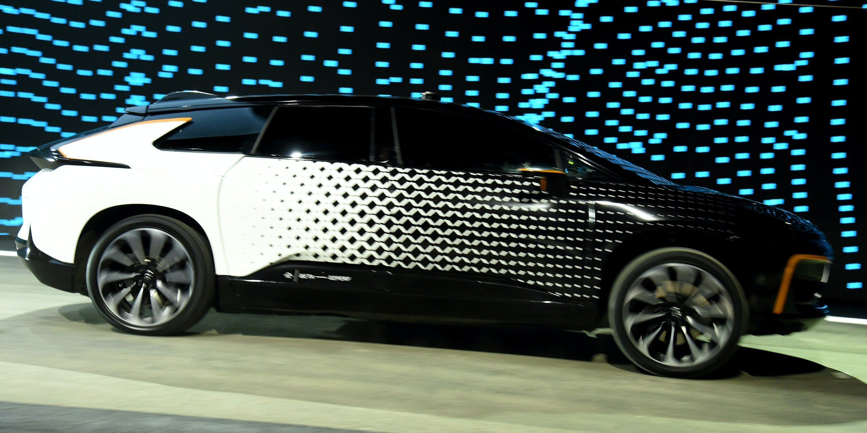 Faraday Future's FF 91 prototype electric crossover vehicle is shown during a speed test as it is unveiled during a press event for CES 2017 at The Pavilions at Las Vegas Market on January 3, 2017 in Las Vegas, Nevada. The 1,050-horsepower FF 91 features autonomous driving with 3D lidar and can go from 0 to 60 mph in 2.39 seconds. CES, the world's largest annual consumer technology trade show, runs from January 5-8 and is expected to feature 3,800 exhibitors showing off their latest products and services to more than 165,000 attendees.
