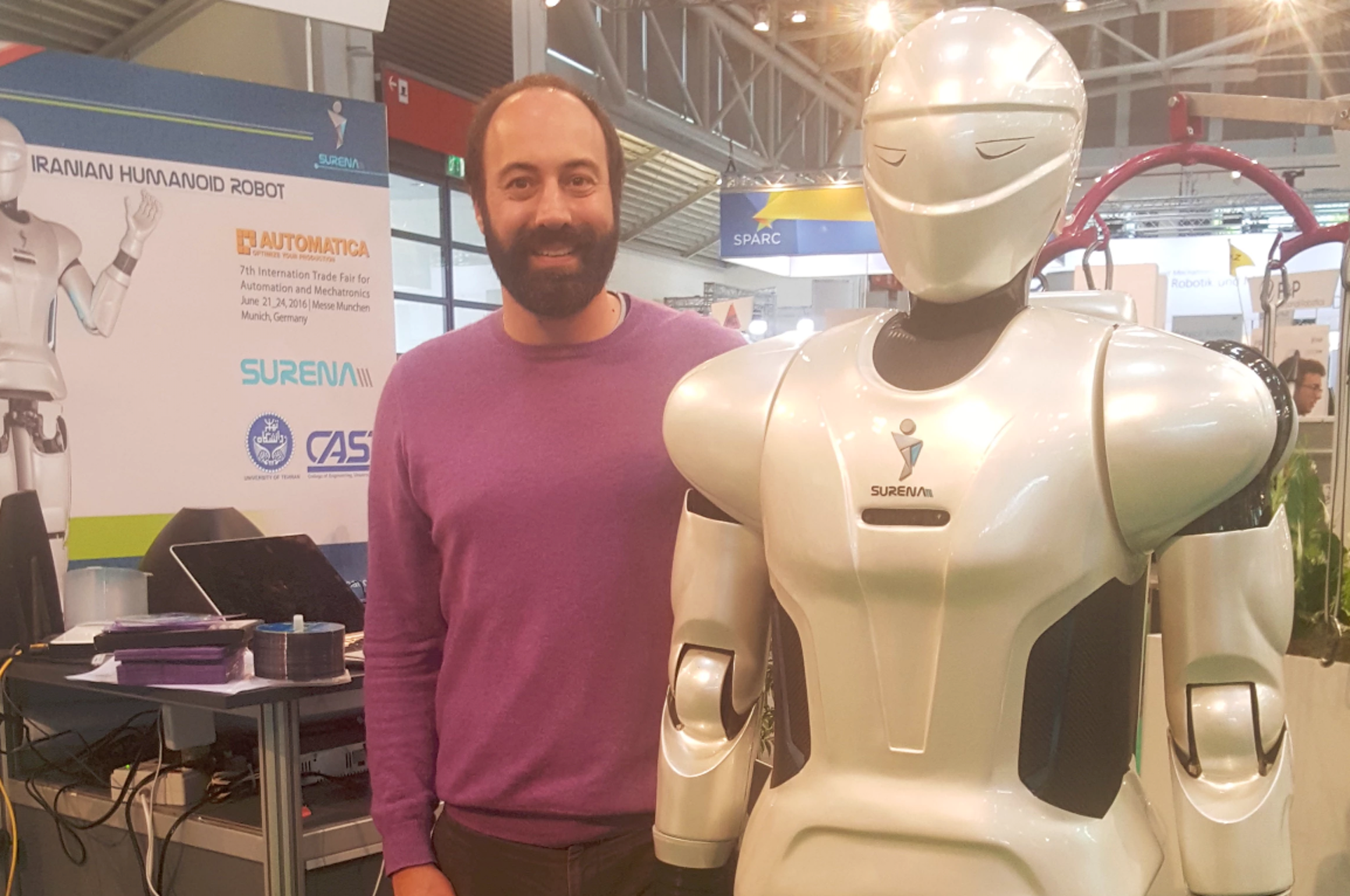 Ryan Calo and a colleague at a trade show in Germany.