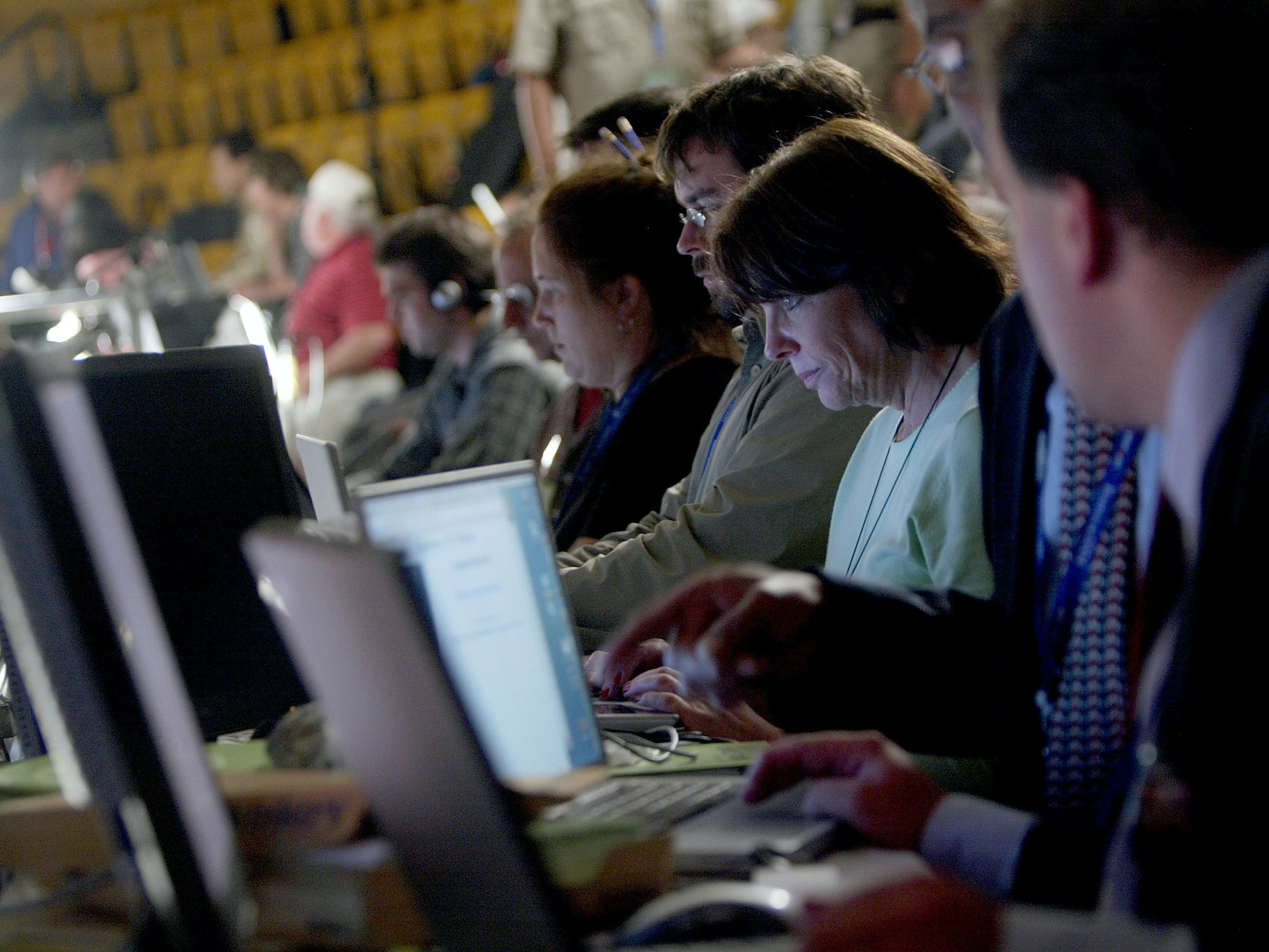 Internet bloggers work on their web log stories during the Democratic National Convention at the FleetCenter July 26, 2004 in Boston, Massachusetts. Democratic presidential candidate U.S. Senator John Kerry (D-MA) is expected to accept his party's nomination later in the week.