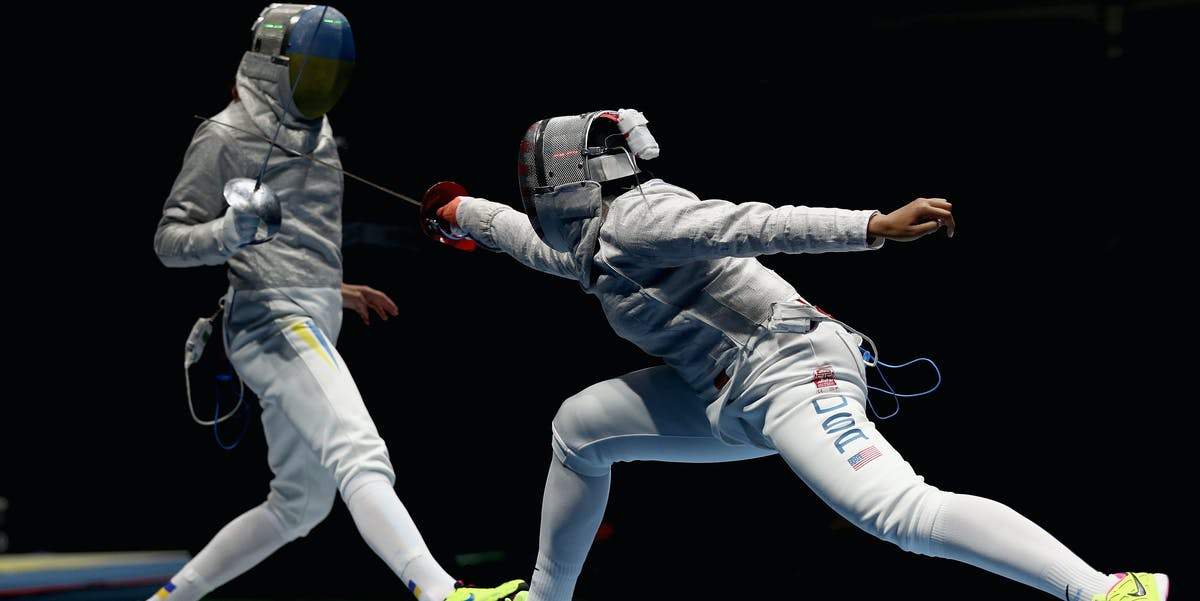 By staying low and springing forward from a strong back leg, team USA's Ibtihaj Muhammad (right) maximizes speed and force.