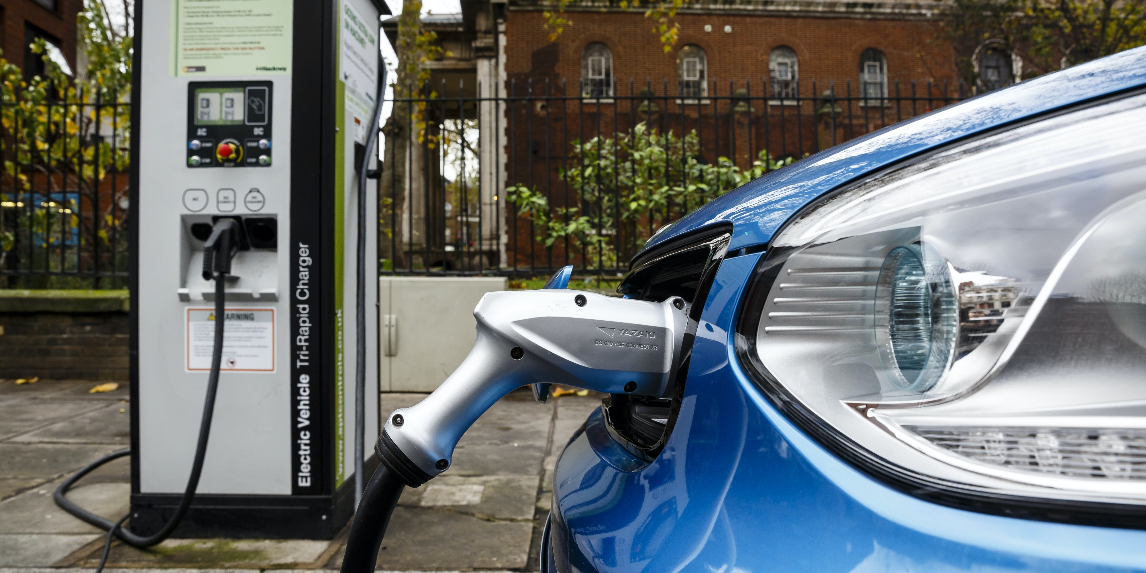 Go Ultra Low Kia Soul EV on charge on a London street. Ultra-low emission vehicles such as this can cost as little as 2p per mile to run and some electric cars and vans have a range of up to 700 miles.