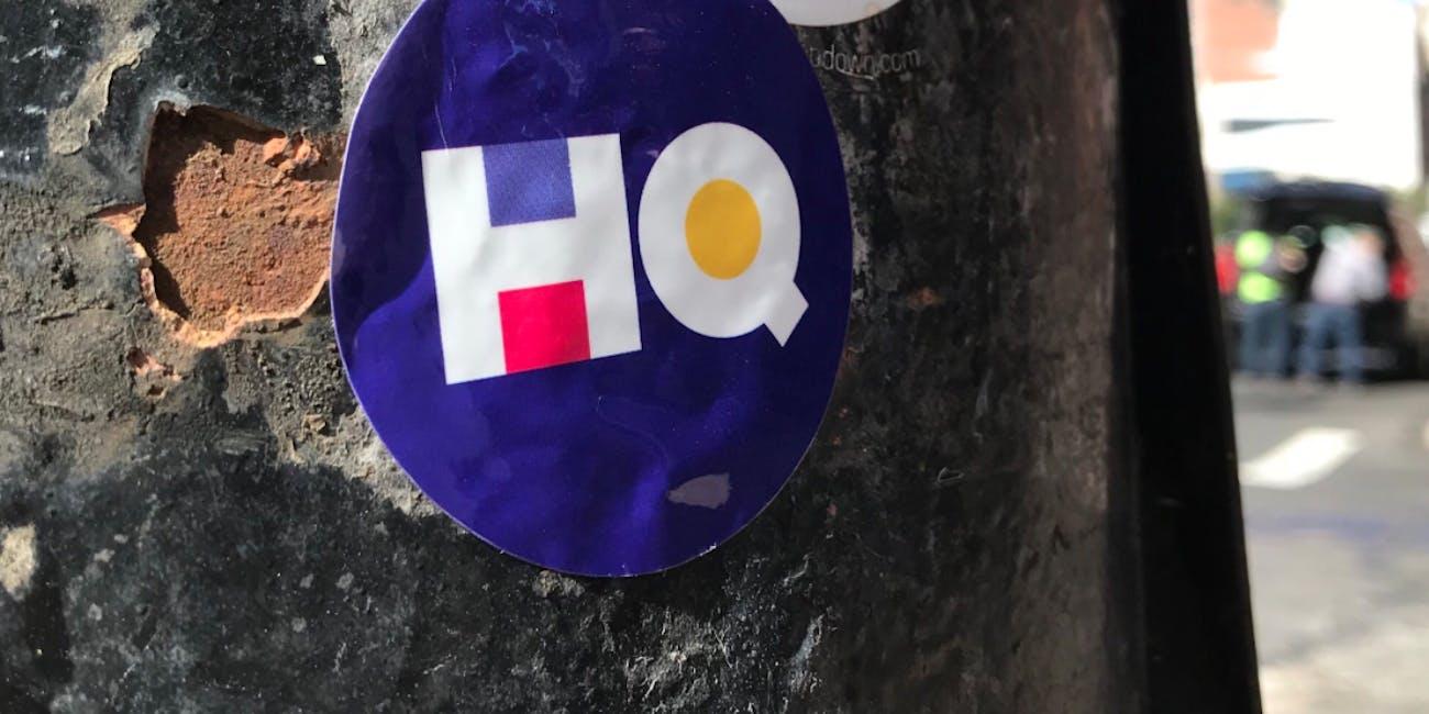 HQ sticker on a light pole in Soho