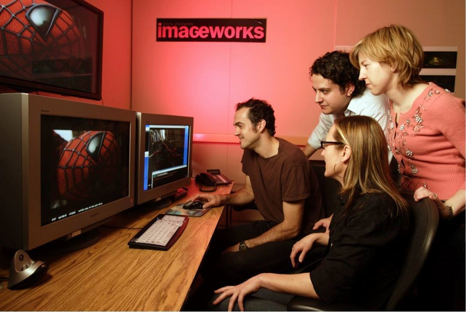 The team from visual effects studio Imageworks, including Scott Stokdyk (left) review a shot from Spider-Man 2.