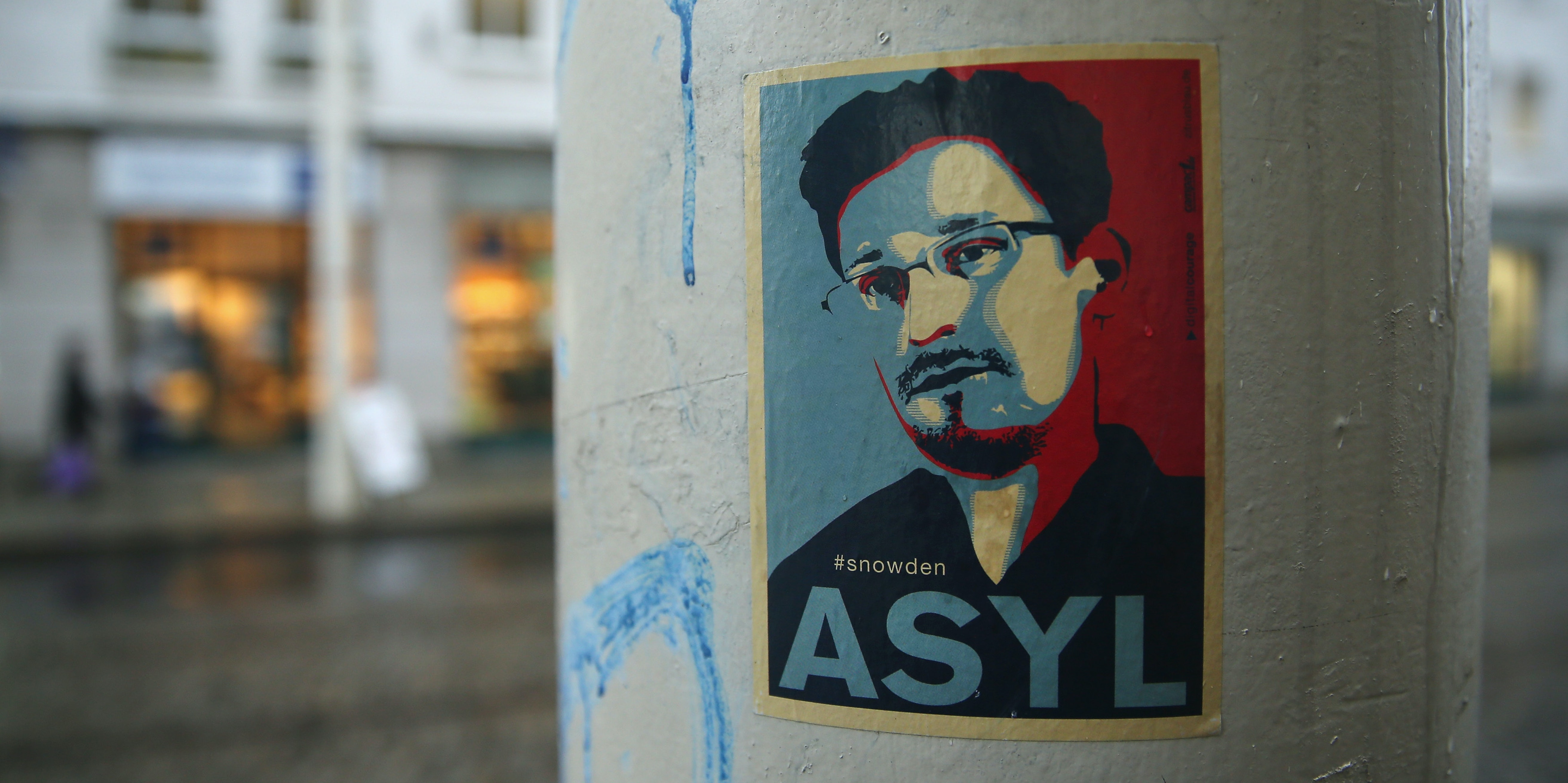 DRESDEN, GERMANY - JANUARY 05:  A sticker demanding asylum for whistleblower and former NSA worker Edward Snowden hangs stuck to a lamppost on January 5, 2015 in Dresden, Germany. Many Germans favour granting Snowden asylum in Germany following reports that the NSA has conducted extensive eavesrodpping operations in Germany and even listened in on the mobile phone of German Chancellor Angela Merkel.  (Photo by Sean Gallup/Getty Images)