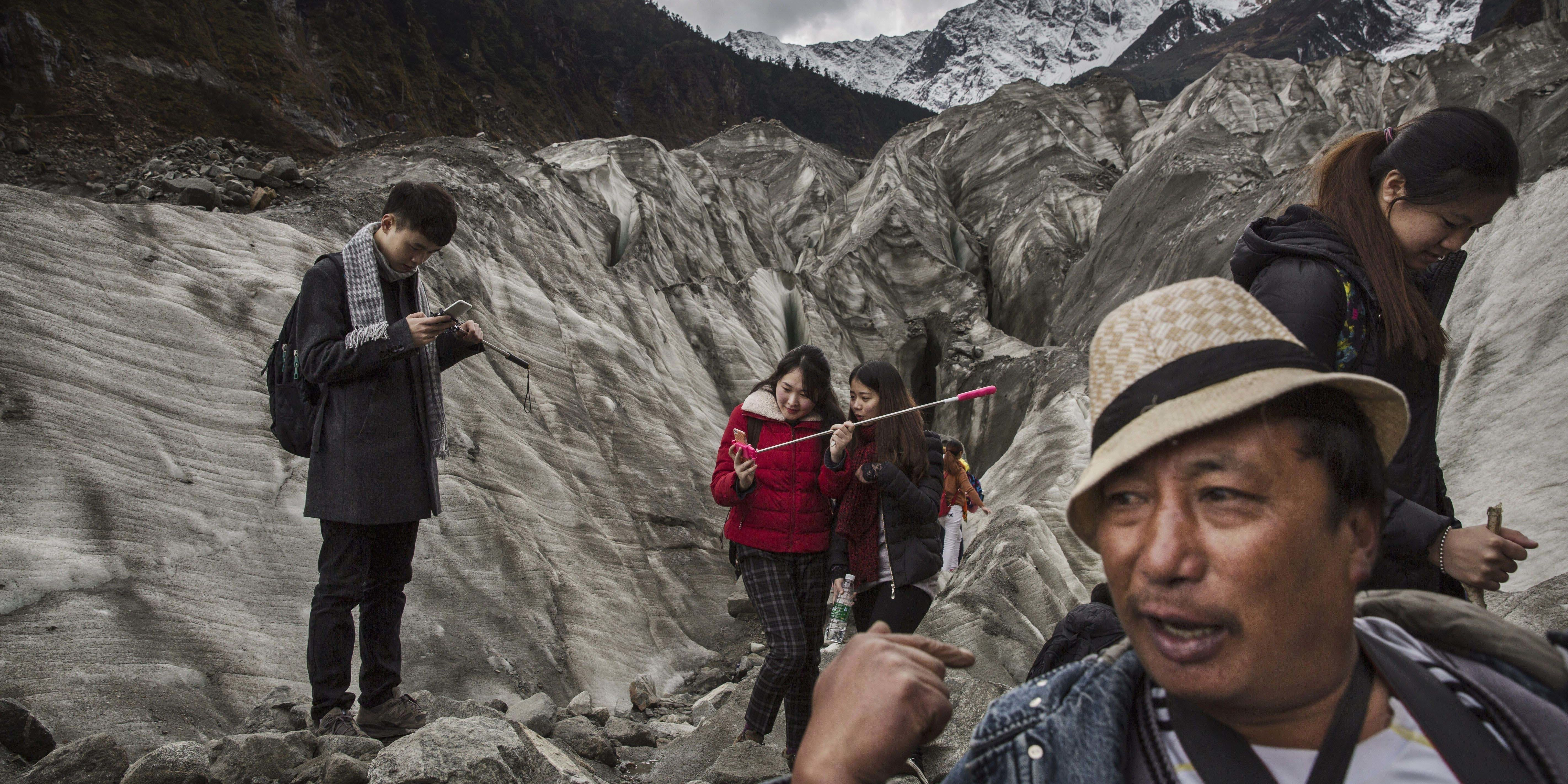 Tourists in China visit a rapidly retreating glacier.
