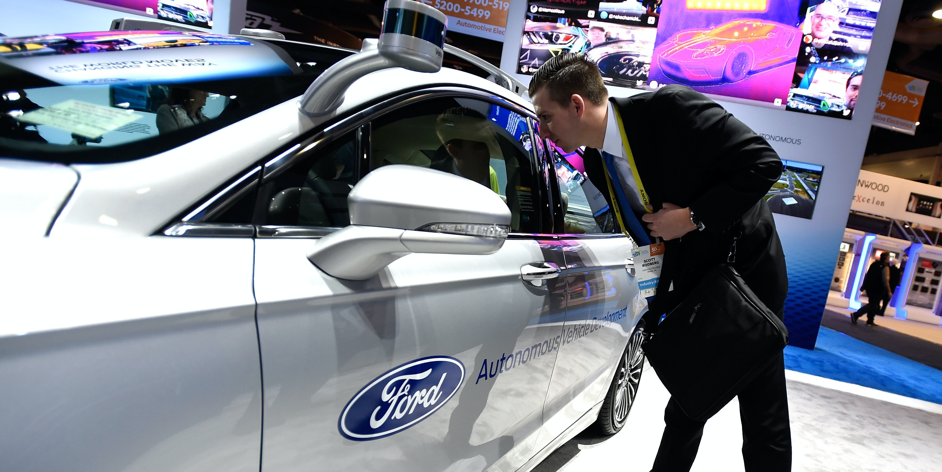 LAS VEGAS, NV - JANUARY 05:  An attendee looks at a Ford Fusion hybrid autonomous development vehicle at the Ford booth at CES 2017 at the Las Vegas Convention Center on January 5, 2017 in Las Vegas, Nevada. CES, the world's largest annual consumer technology trade show, runs through January 8 and features 3,800 exhibitors showing off their latest products and services to more than 165,000 attendees.  (Photo by David Becker/Getty Images)