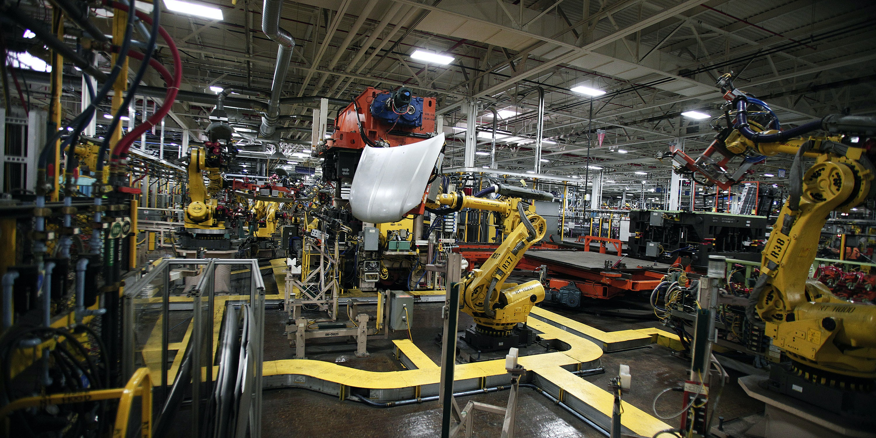 STERLING HEIGHTS, MI - AUGUST 26:  Robots handle parts for Fiat Chrysler Automobiles at the FCA Sterling Stamping Plant August 26, 2016 in Sterling Heights, Michigan. An event was held today at the plant to celebrate the start of production of three all-new stamping presses, whose installation began in July 2015 and cost $166 million. (Photo by Bill Pugliano/Getty Images)