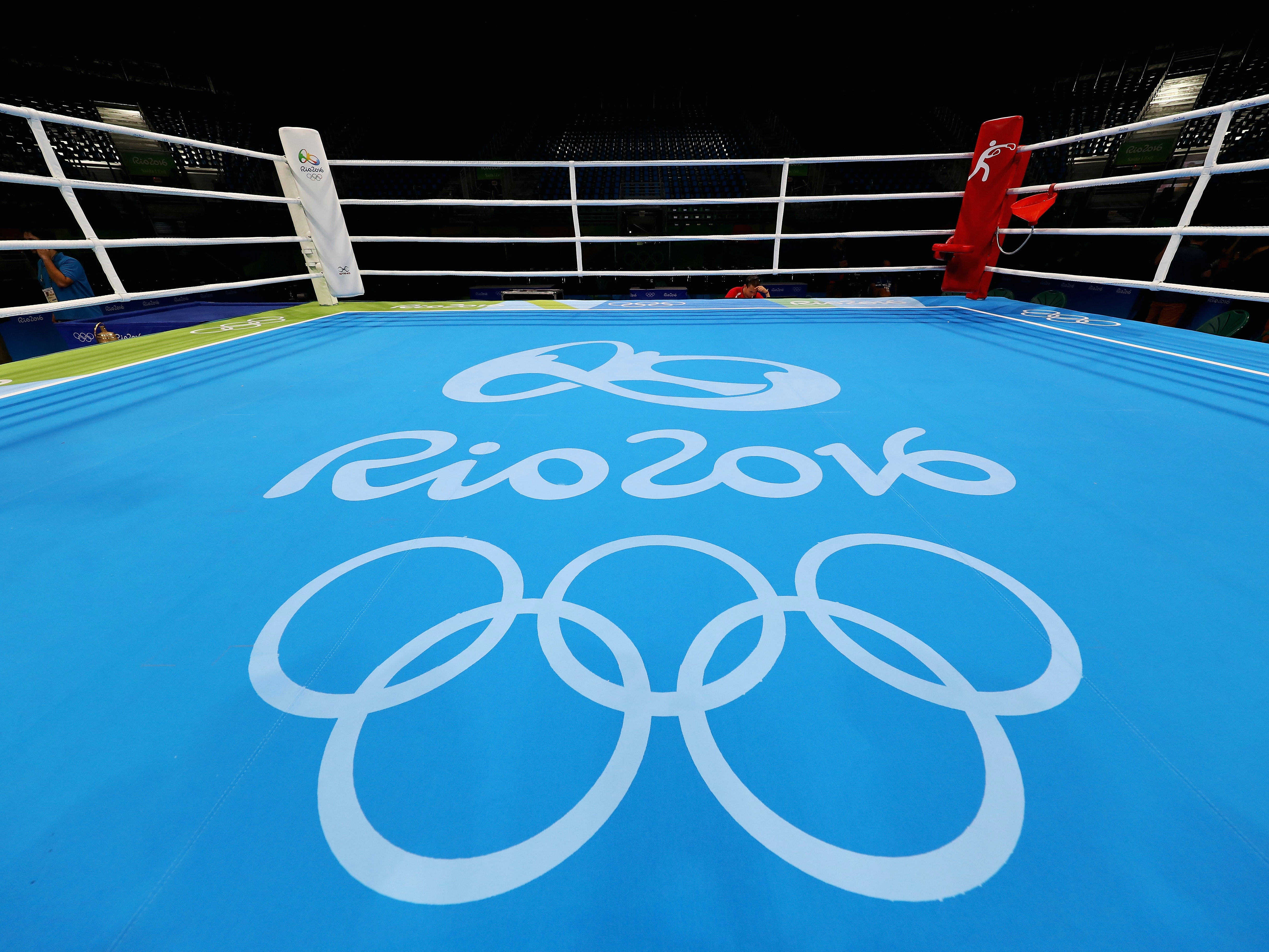RIO DE JANEIRO, BRAZIL - AUGUST 06:  A general view of the empty boxing ring with official logo on the mat prior to Day 1 of the Rio 2016 Olympic Games at Riocentro - Pavilion 6 on August 6, 2016 in Rio de Janeiro, Brazil.  (Photo by Dean Mouhtaropoulos/Getty Images)