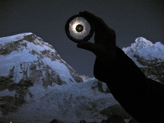 Cowing's photo of him using moon rocks to eclipse the moon.