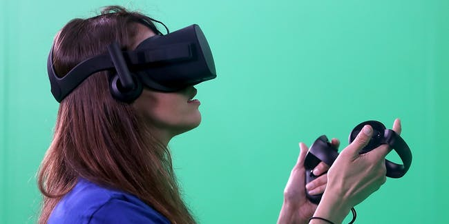 SAN JOSE, CA - APRIL 18:  Adriana Ojeda uses an Oculus headset Facebook's F8 Developer Conference on April 18, 2017 in San Jose, California. Facebook CEO Mark Zuckerberg delivered the opening keynote at the F8 Developer Conference that runs through April 19.  (Photo by Justin Sullivan/Getty Images)