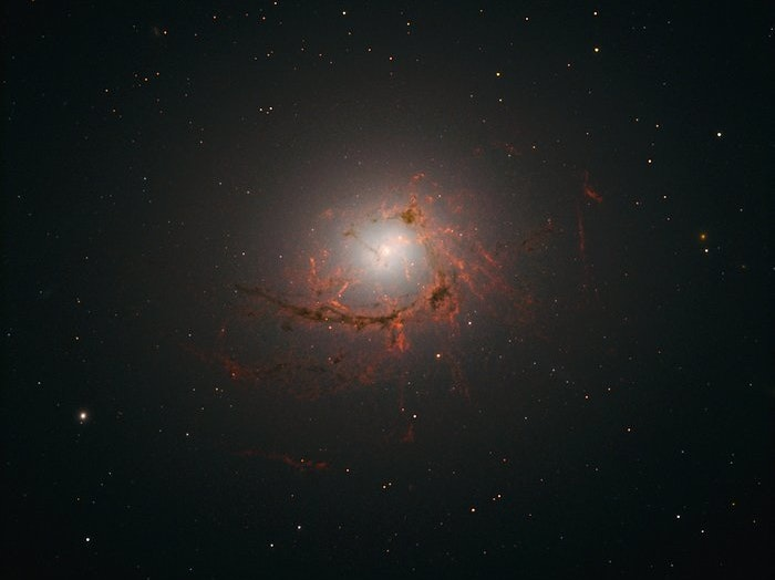 Hubble Spies Distant Black Hole Voraciously Eating Host Galaxy