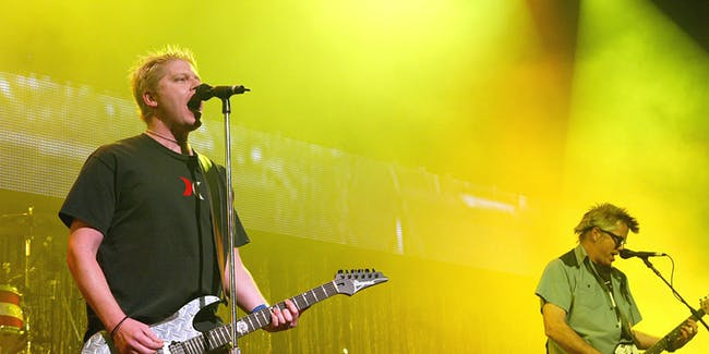 LOS ANGELES - DECEMBER 13:  The Offspring, with singer Dexter Holland, performs at KROQ's 2003 Almost Acoustic Christmas at the Universal Amphitheatre on December 13, 2003 in Los Angeles, California. (Photo by Kevin Winter/Getty Images)