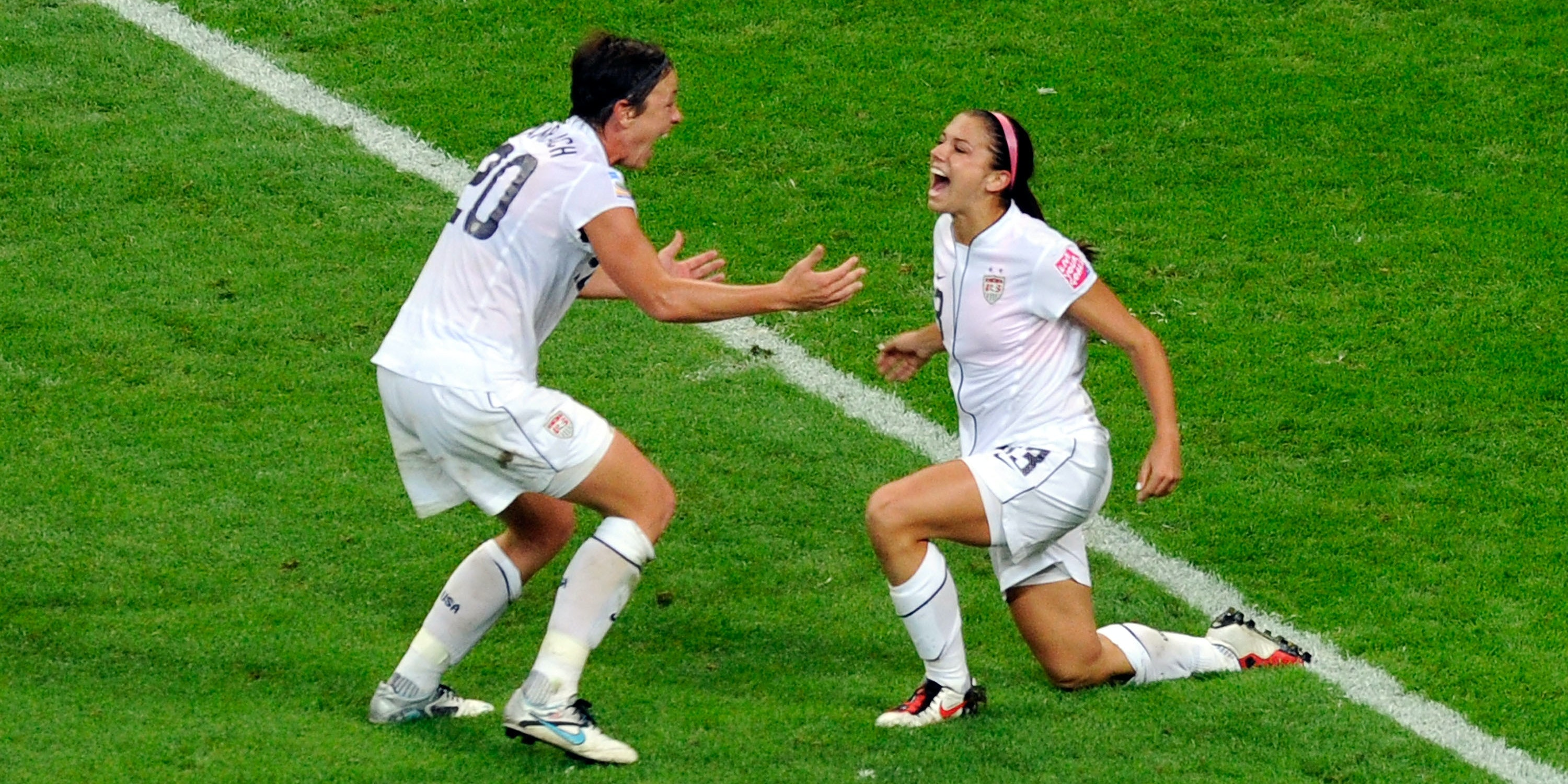 FRANKFURT AM MAIN, GERMANY - JULY 17: Alex Morgan (R) of United States celebrates with team mate Abby Wambach after scoring her teams first goal during the FIFA Womens's World Cup Final between the United States of America and Japan at FIFA Word Cup stadium on July 17, 2011 in Frankfurt am Main, Germany. (Photo by Thorsten Wagner/Getty Images)