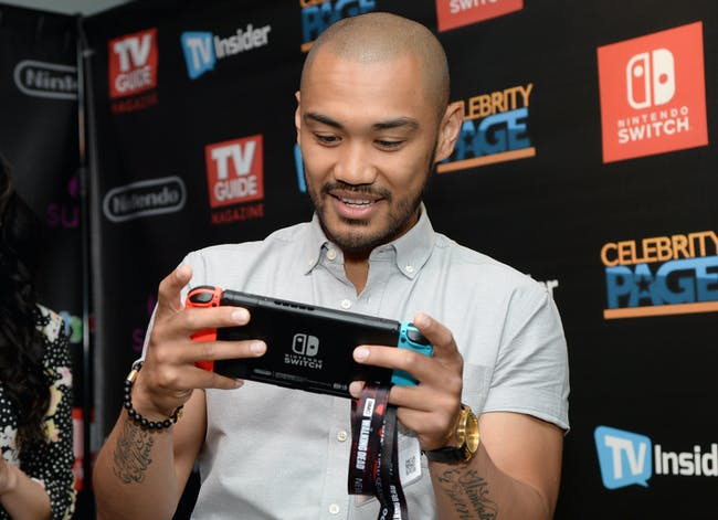 Actor Alex Mallari Jr from the television series 'Dark Matter' with a Nintendo Switch.