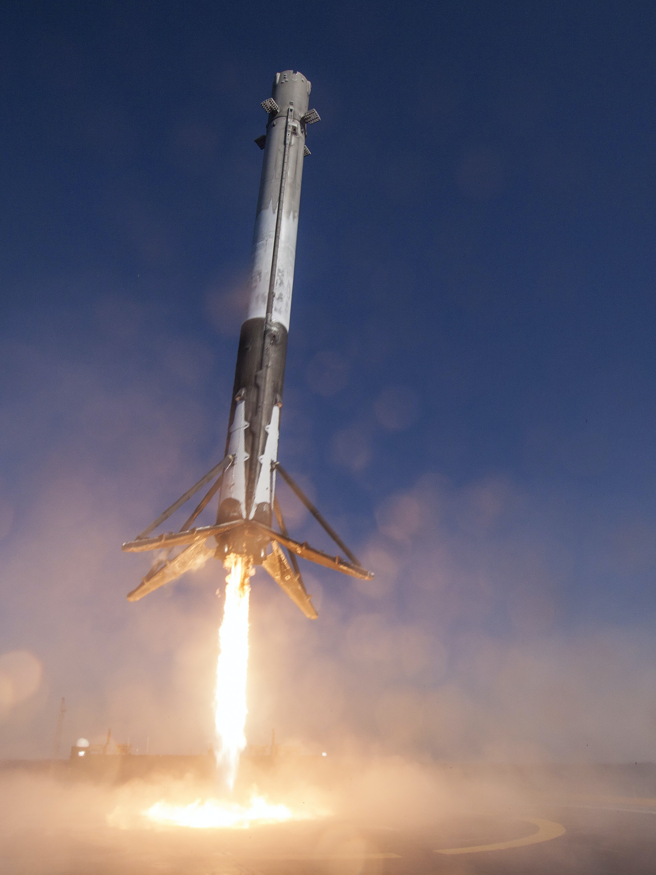 CAPE CANAVERAL, FL - APRIL 8: In this handout provided by the National Aeronautics and Space Administration (NASA), SpaceX's Falcon 9 rocket makes its first successful upright landing on the 'Of Course I Still Love You' droneship on April 8, 2016 some 200 miles off shore in the Atlantic Ocean after launching from Cape Canaveral, Florida. (Photo by NASA via Getty Images)