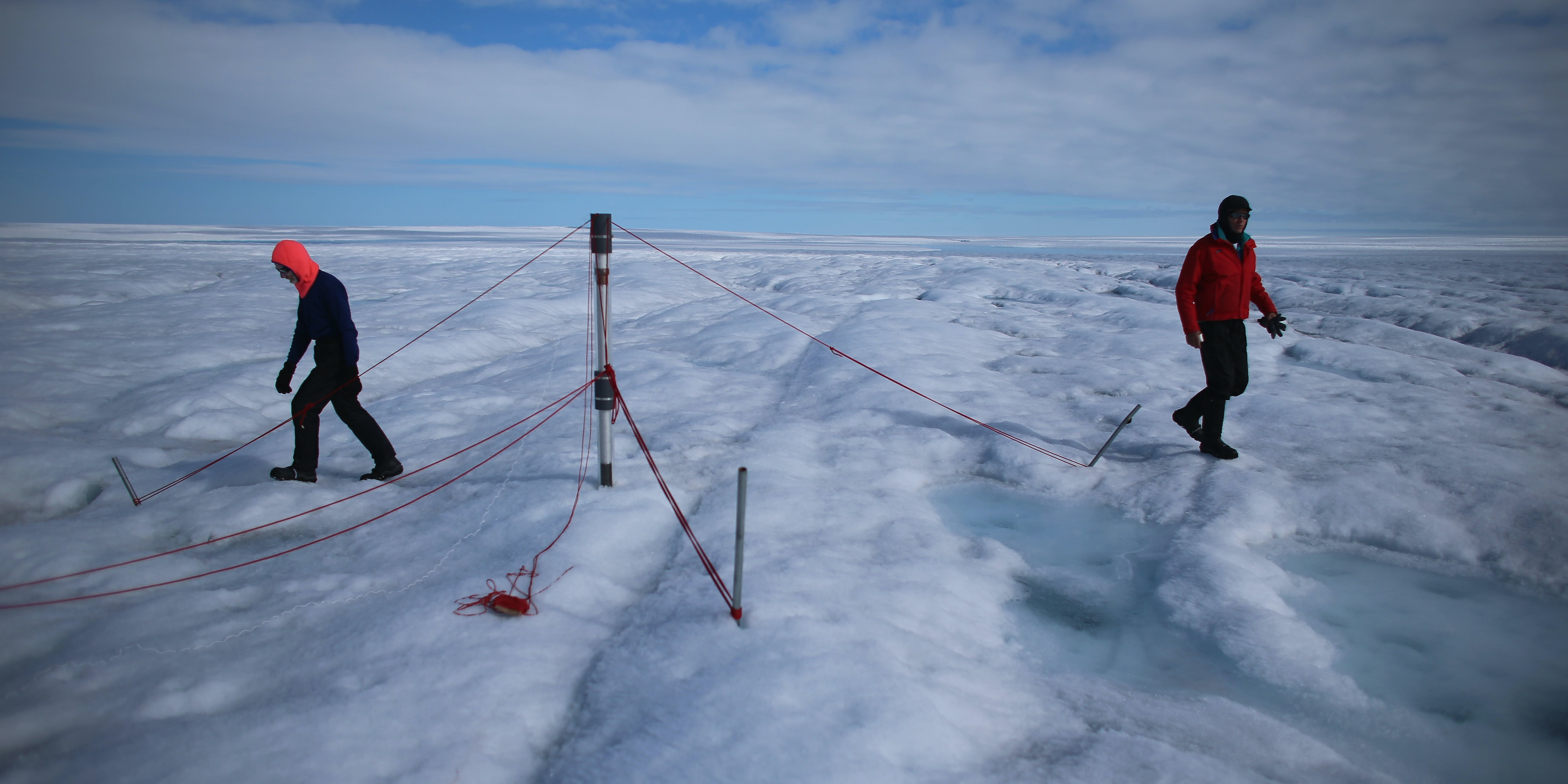 Scientists study glacial ice melt in Greenland.