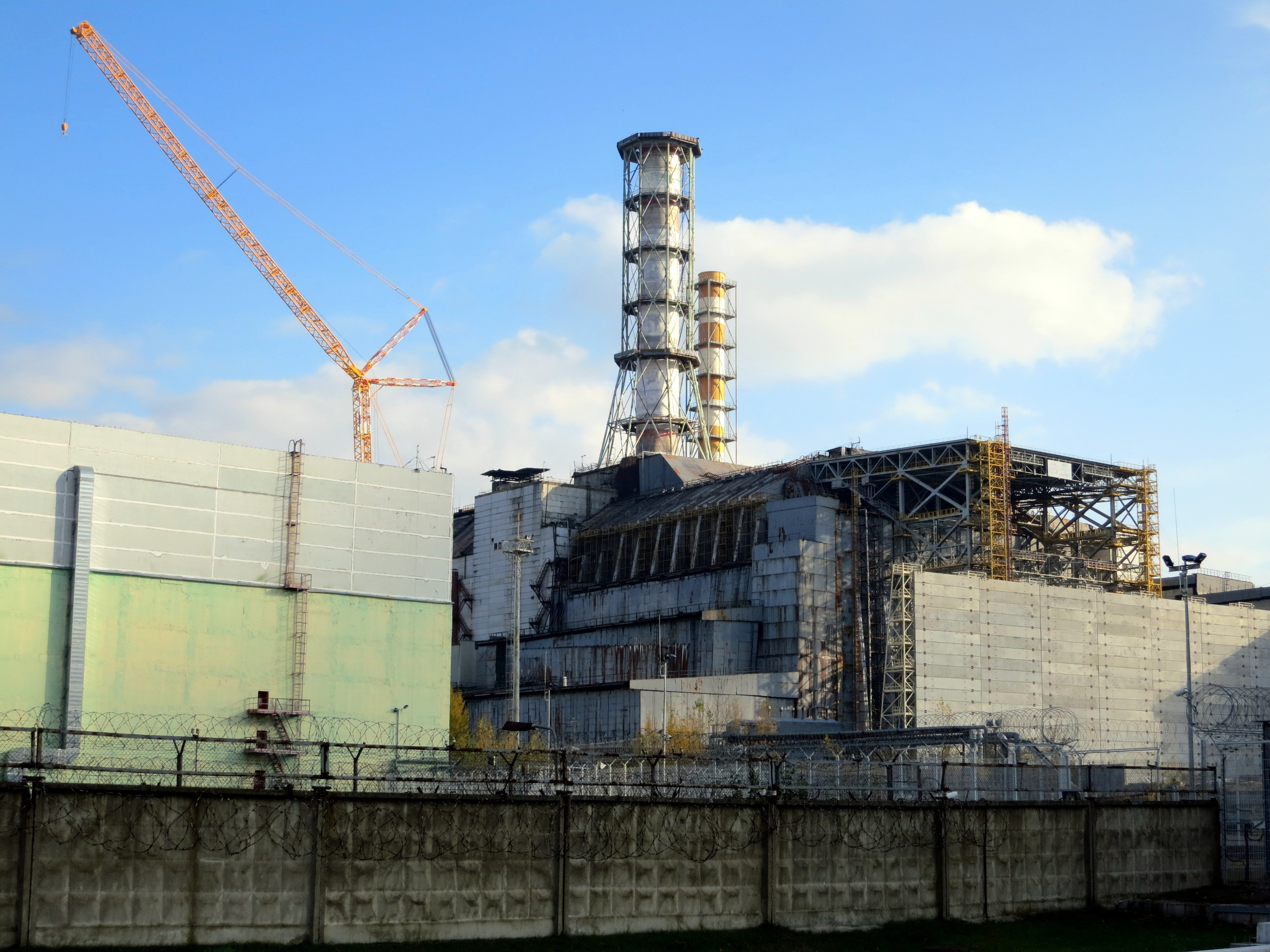 Residual radiation at Chernobyl persists because the blast was more massive and took place on the ground.