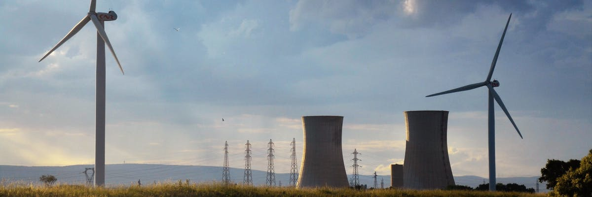 old nuclear power plant & new wind turbine