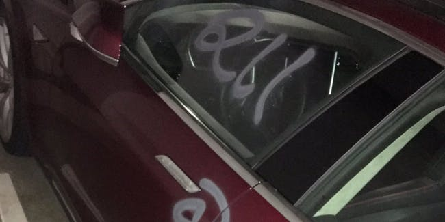 Somebody in San Francisco tagged a Tesla with its stock price.