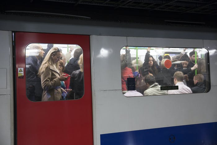 Commuters travel on the District Line of the London Underground.
