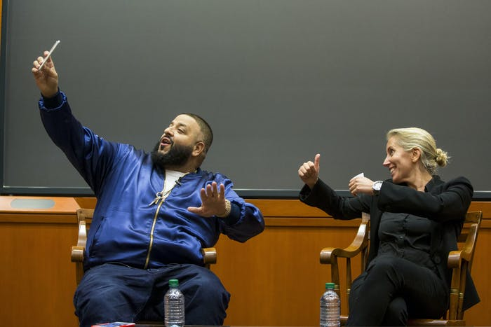 CAMBRIDGE, MA - DECEMBER 09: DJ Khaled posts a Snapchat with Harvard Business School Professor of Business Administration, Anita Elberse, during the Get Schooled Snapchat College Tour and Meet at Harvard University on December 9, 2016 in Cambridge, Massachusetts. (Photo by Scott Eisen/Getty Images for Get Schooled Foundation)