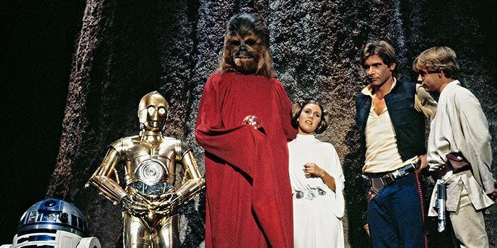 Chewbacca, Han Solo, Leia Organa, Luke Skywalker, R2-D2, and C3PO on Kashyyyk for the Life Day celebration