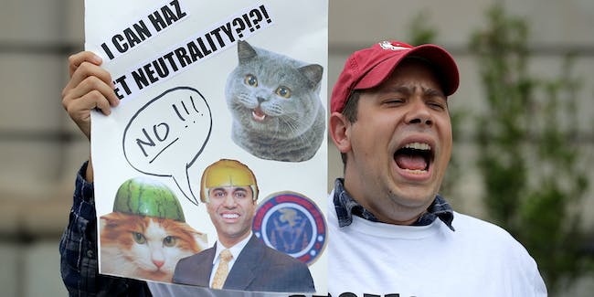 WASHINGTON, DC - MAY 05: Proponents of net neutrality protest against Federal Communication Commission Chairman Ajit Pai outside the American Enterprise Institute before his arrival May 5, 2017 in Washington, DC. Appointed to the commission by President Barack Obama in 2012, Pai was elevated to the chairmanship of the FCC by U.S. President Donald Trump in January. (Photo by Chip Somodevilla/Getty Images)