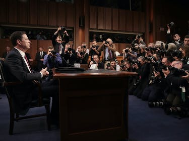 WASHINGTON, DC - JUNE 08: Former FBI Director James Comey (L) prepares to testify before the Senate Intelligence Committee in the Hart Senate Office Building on Capitol Hill June 8, 2017 in Washington, DC. Comey said that President Donald Trump pressured him to drop the FBI's investigation into former National Security Advisor Michael Flynn and demanded Comey's loyalty during the one-on-one meetings he had with president. (Photo by Drew Angerer/Getty Images)