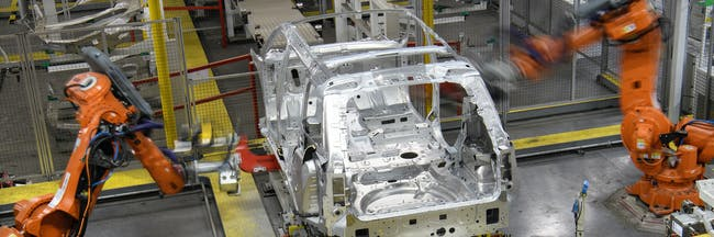 SOLIHULL, ENGLAND - MARCH 06:  Robotic systems work on the chassis of a car during an automated stage of production at the Jaguar Land Rover factory on March 1, 2017 in Solihull, England. The company has pledged it's 'heart and soul' to production in the UK after producing the new 'Velar' model for global sale, at their Solihull factory.  (Photo by Leon Neal/Getty Images)
