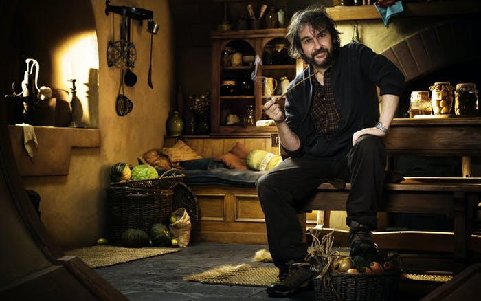 Peter Jackson poses inside of the set of Bilbo Baggins's house.