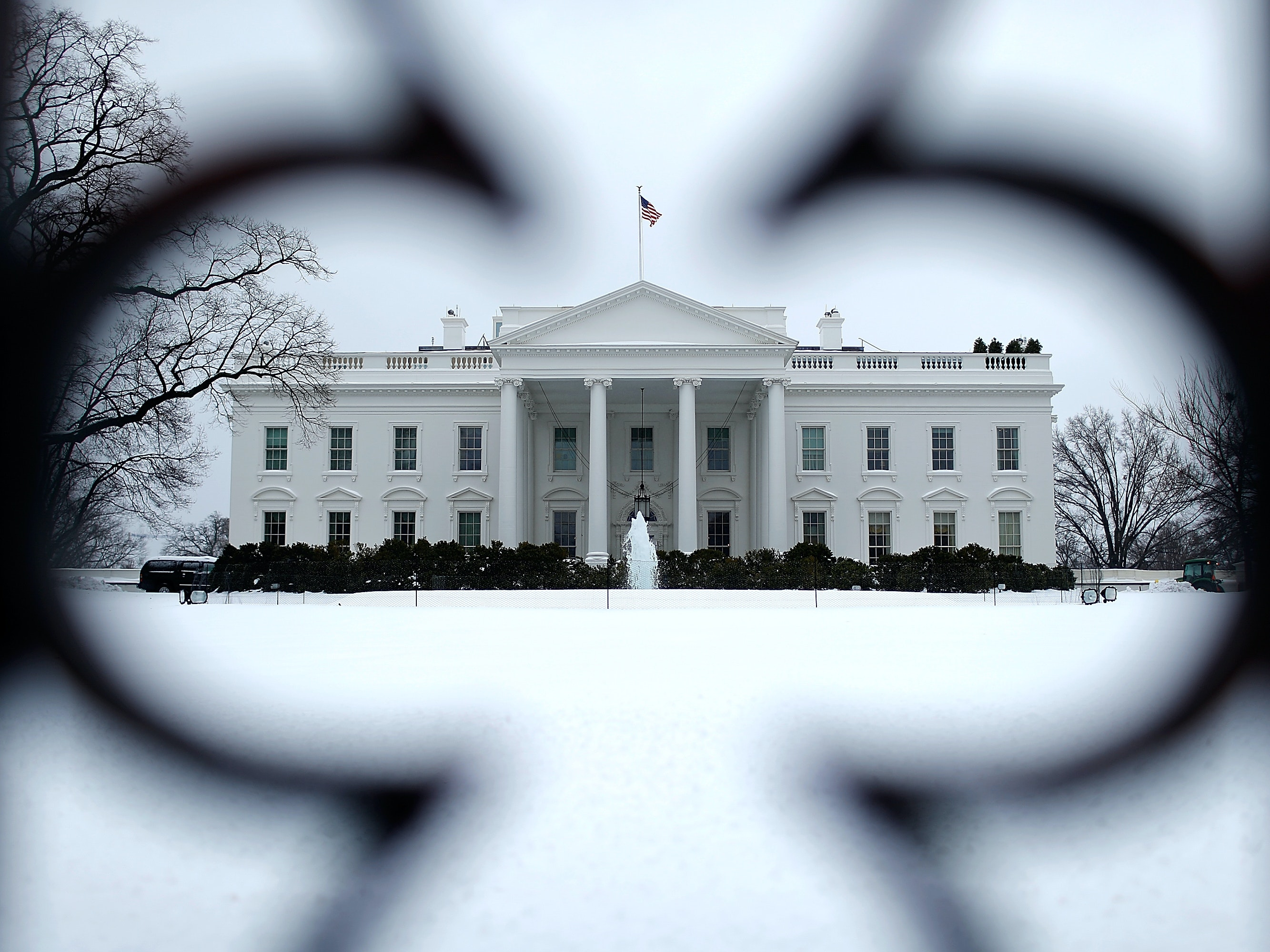 WASHINGTON, DC - FEBRUARY 13:  The White House north lawn is covered in snow February 13, 2014 in Washington, DC. The east coast of the U.S. was hit with a winter storm leaving up to 12 inches of snow on the ground in parts of the Washington, DC area.  (Photo by Win McNamee/Getty Images)