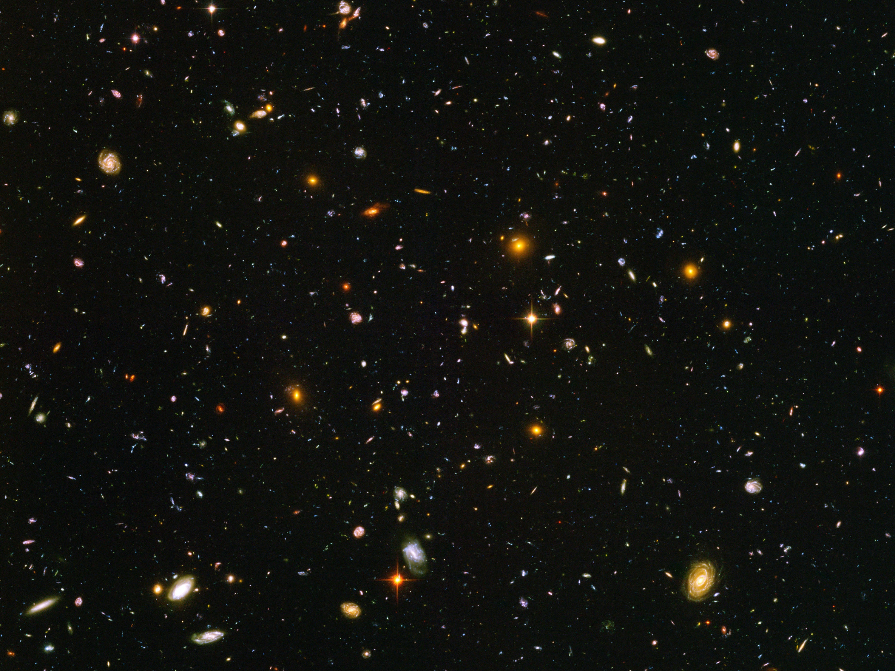 A view of nearly 10,000 galaxies are seen in a Hubble Telescope composite photograph released March 9, 2004. The Hubble Ultra Deep Field (HUDF) photograph is a composite of a million one-second exposures and reveals galaxies from the time shortly after the big bang.  (Photo by NASA/Getty Images)