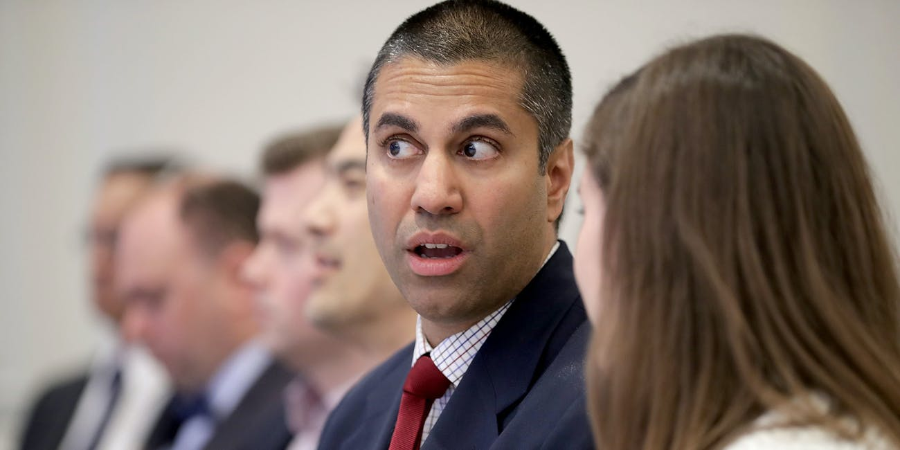 WASHINGTON, DC - MAY 05: Federal Communication Commission Chairman Ajit Pai (2nd R) prepares to deliver remarks and participate in a discussion at The American Enterprise Institute for Public Policy Research May 5, 2017 in Washington, DC. Appointed to the commission by President Barack Obama in 2012, Pai was elevated to the chairmanship of the FCC by U.S. President Donald Trump in January. (Photo by Chip Somodevilla/Getty Images)