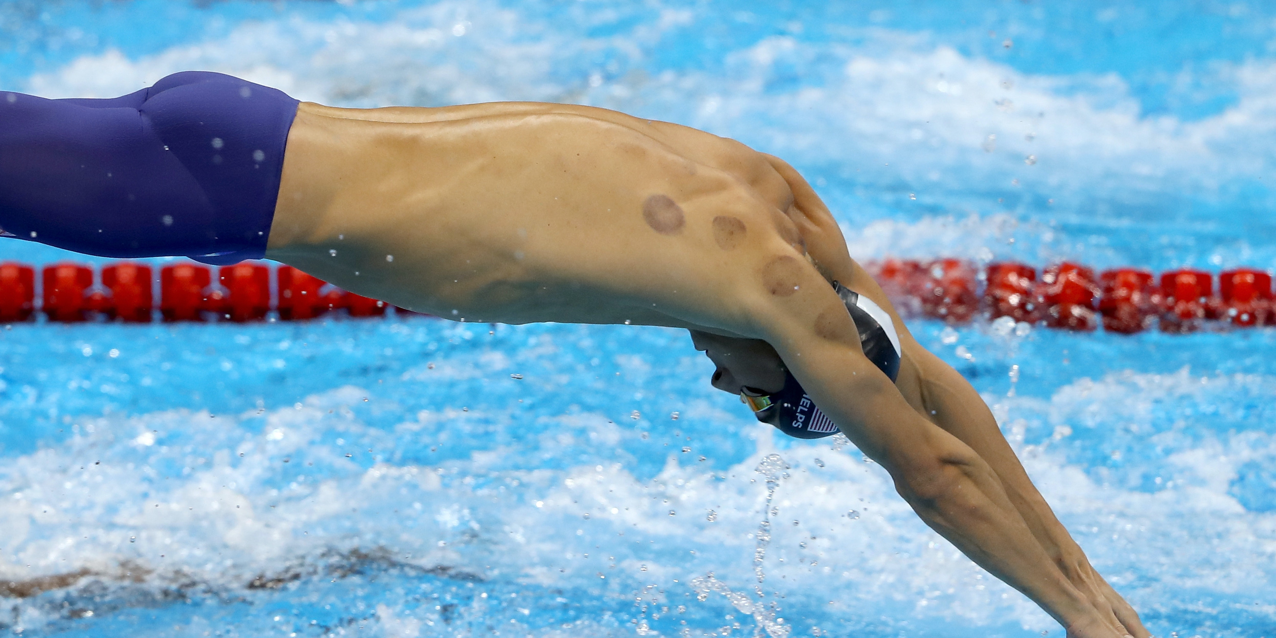 RIO DE JANEIRO, BRAZIL - AUGUST 07:  Michael Phelps of the United States competes in the Final of the Men's 4 x 100m Freestyle Relay on Day 2 of the Rio 2016 Olympic Games at the Olympic Aquatics Stadium on August 7, 2016 in Rio de Janeiro, Brazil.  (Photo by Al Bello/Getty Images)