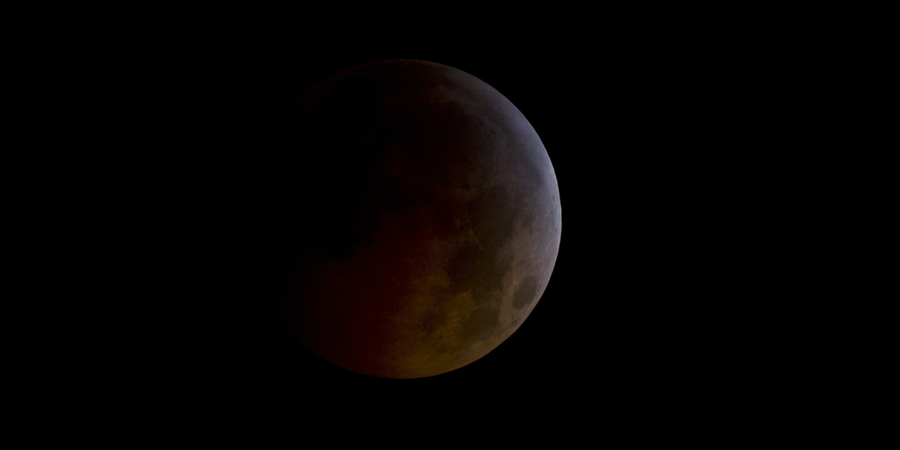 ARLINGTON, VA - DECEMBER 21:  In this handout photo provided by NASA, A total lunar eclipse is seen as the full moon is shadowed by the Earth on the arrival of the winter solstice, on December 21, 2010 in Arlington, Virginia.  It is the first lunar eclipse that has coincided with the Winter Solstice, the shortest day of the year, since 1638.   (Photo by Bill Ingalls/NASA via Getty Images)