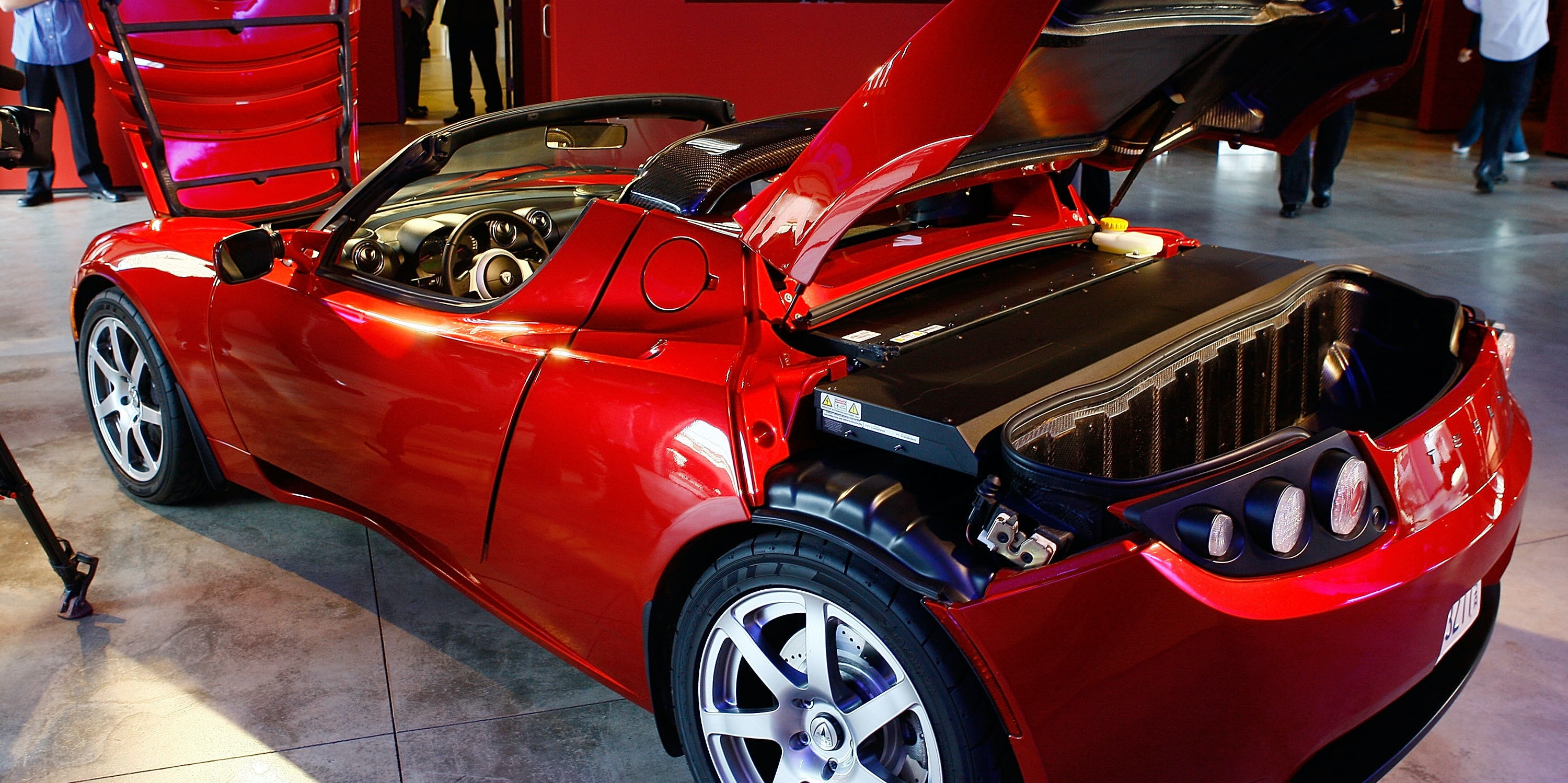 LOS ANGELES, CA - MAY 01:  The Tesla Roadster, the world's first highway-capable all electric car available in the United States, is displayed on its production debut in the Tesla Flagship Store on May 1, 2008 in Los Angeles, California.  (Photo by Vince Bucci/Getty Images)