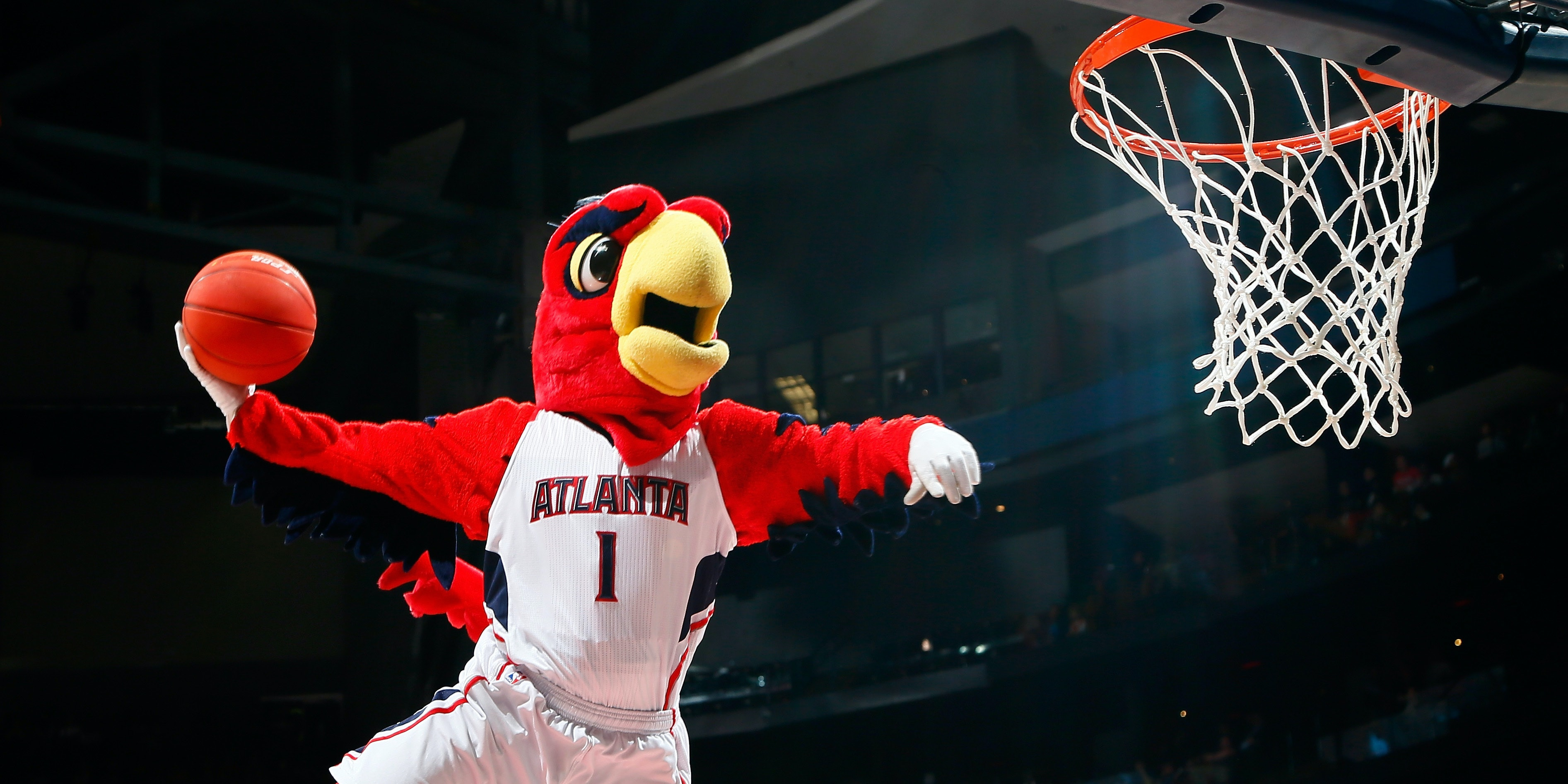 Harry the Hawk, mascot of the Atlanta Hawks, dunks during a timeout in the game between the Atlanta Hawks and the Brooklyn Nets at Philips Arena on January 28, 2015 in Atlanta, Georgia.