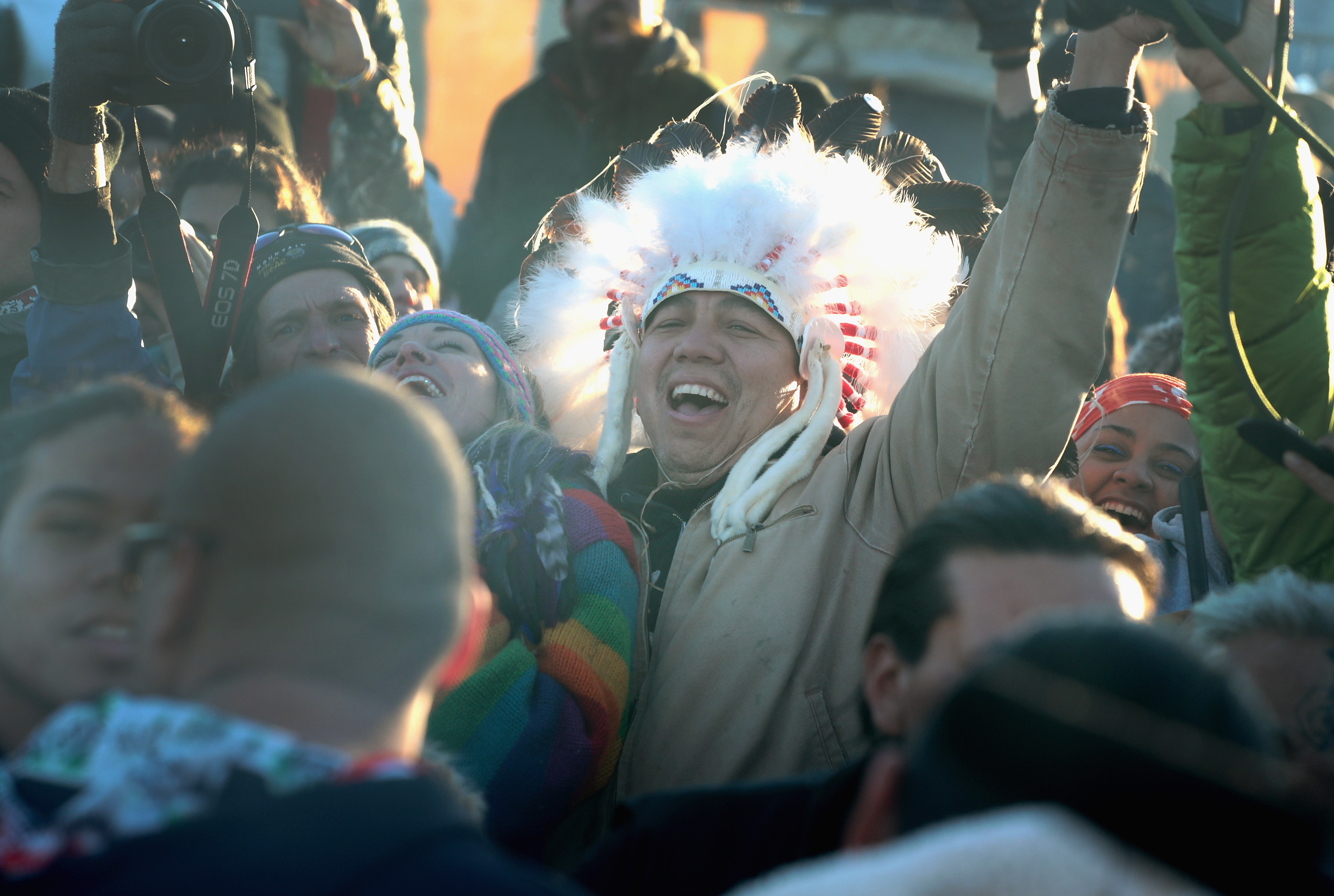 Native American and other activists celebrate after learning an easement had been denied for the Dakota Access Pipeline at Oceti Sakowin Camp on the edge of the Standing Rock Sioux Reservation on December 4, 2016 outside Cannon Ball, North Dakota.