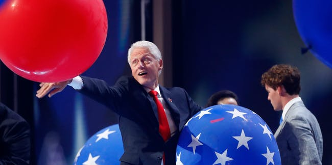 PHILADELPHIA, PA - JULY 28:  Former US President Bill Clinton plays with balloons on stage at the end of the fourth day of the Democratic National Convention at the Wells Fargo Center, July 28, 2016 in Philadelphia, Pennsylvania. Democratic presidential candidate Hillary Clinton received the number of votes needed to secure the party's nomination. An estimated 50,000 people are expected in Philadelphia, including hundreds of protesters and members of the media. The four-day Democratic National Convention kicked off July 25.  (Photo by Aaron P. Bernstein/Getty Images)