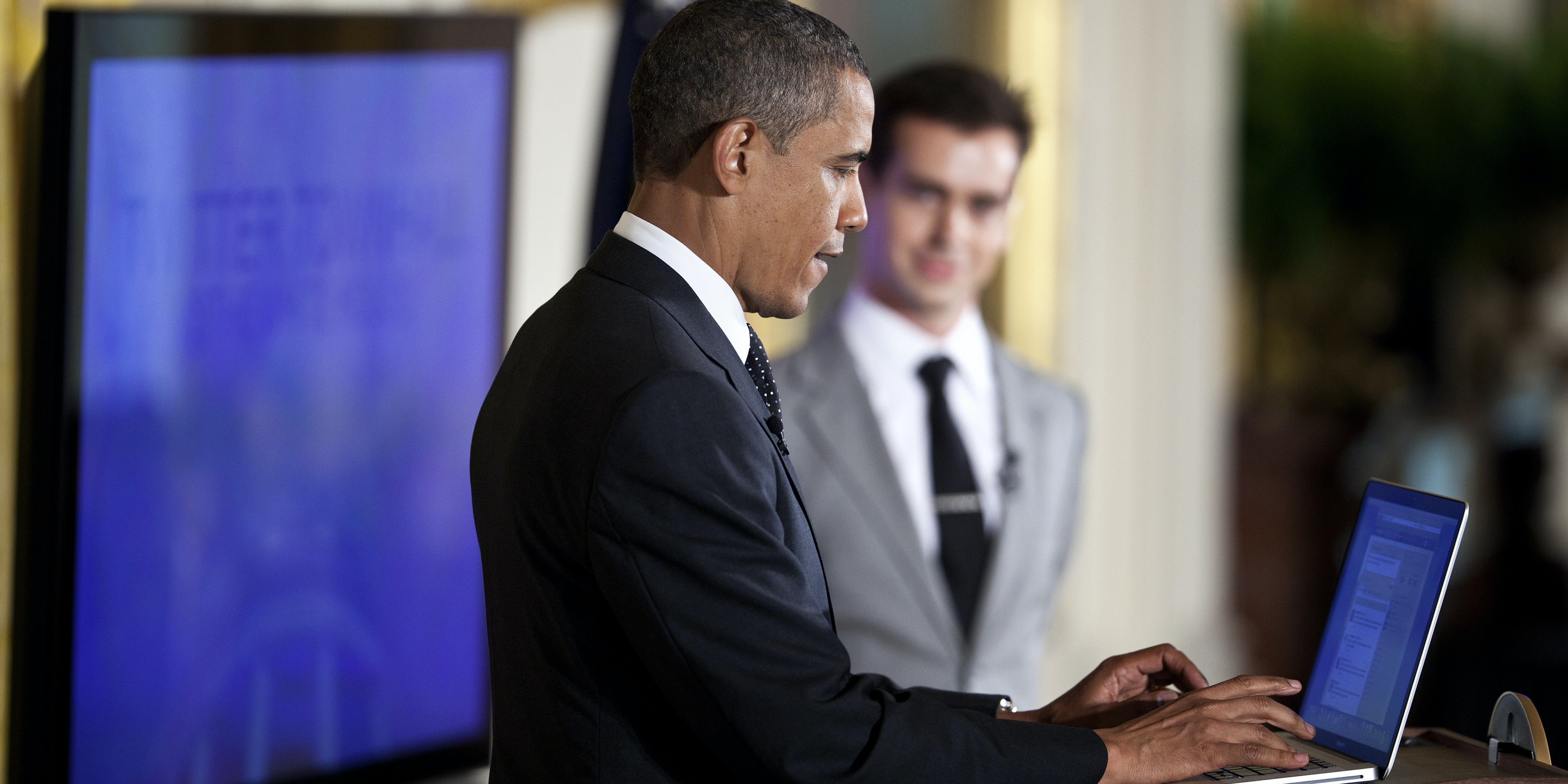 WASHINGTON - JULY 6:  U.S. President Barack Obama posts a Tweet during an online Twitter town hall meeting from the East Room of the White House July 6, 2011 in Washington, DC.  Obama and Twitter co-founder and Executive Chairman Jack Dorsey held the online discussion to speak about the U.S .debt ceiling crisis.  (Photo by Brendan Smialowski/Getty Images)