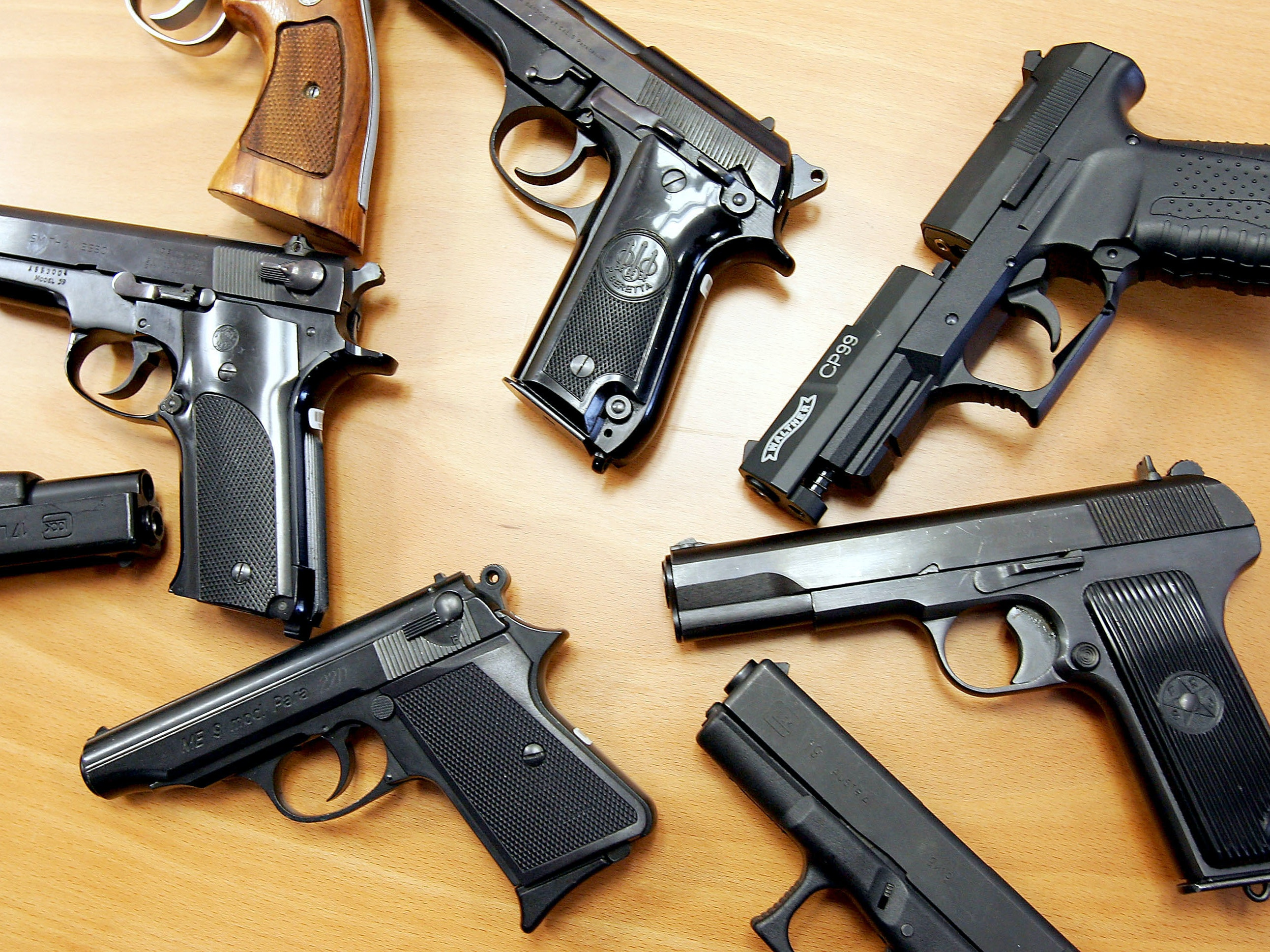 A haul of firearms recovered in recent police operations sits on a table during a press conference on June 22, 2005 in London, England. Urban Concepts along with the British police force announced their 'Don't Trigger Campaign' which aims to unite the nation against gun crime.