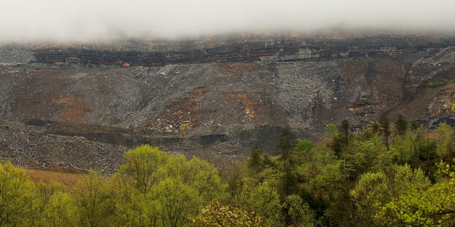 Surface mining operations are seen beneath low lying clouds in the Appalachian Mountains on April 18, 2012 in Partridge, Kentucky. Some types of surface mining on montains are known as 'mountaintop removal mining' which has destroyed 500 mountain peaks and at least 1,200 miles of streams while leading to increased flooding. The Appalachians are some of the oldest mountains on Earth.