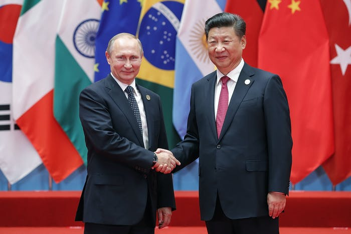"""State sponsored"" probably means one of these dudes (Russian President Vladimir Putin and Chinese President Xi Jinping)."