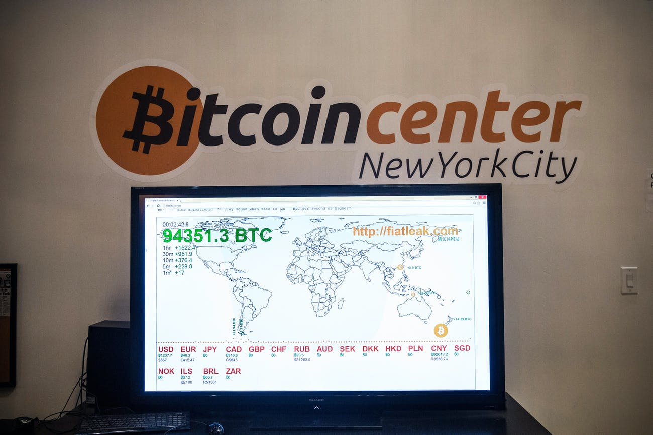 NEW YORK, NY - FEBRUARY 26: A television screen displays various bitcoin rates at Bitcoin Center NYC during a class on the basics of Bitcoin and how to trade the digital currency on February 26, 2014 in New York City. The recently opened center offers a physical space for people to trade digital currencies, including bitcoin. Bitcoin Center NYC also offers classes for people interested in learning about digital currencies. (Photo by Andrew Burton/Getty Images)